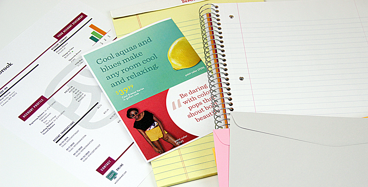 A notebook, a brochure and a color chart, printed on Domtar paper