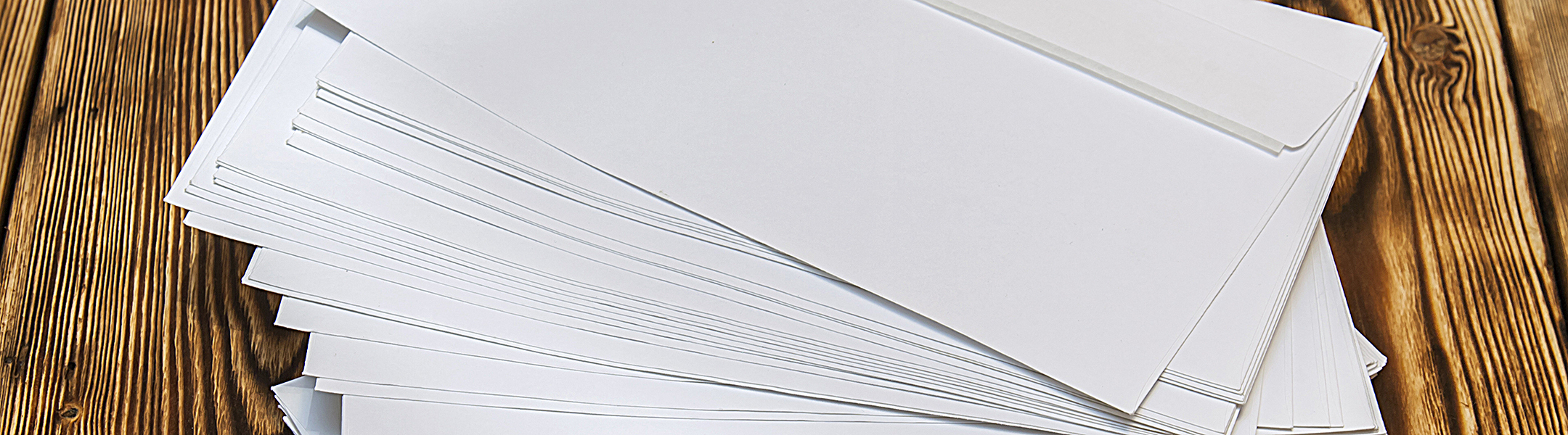 A stack of envelopes made with Domtar White Wove Envelope paper