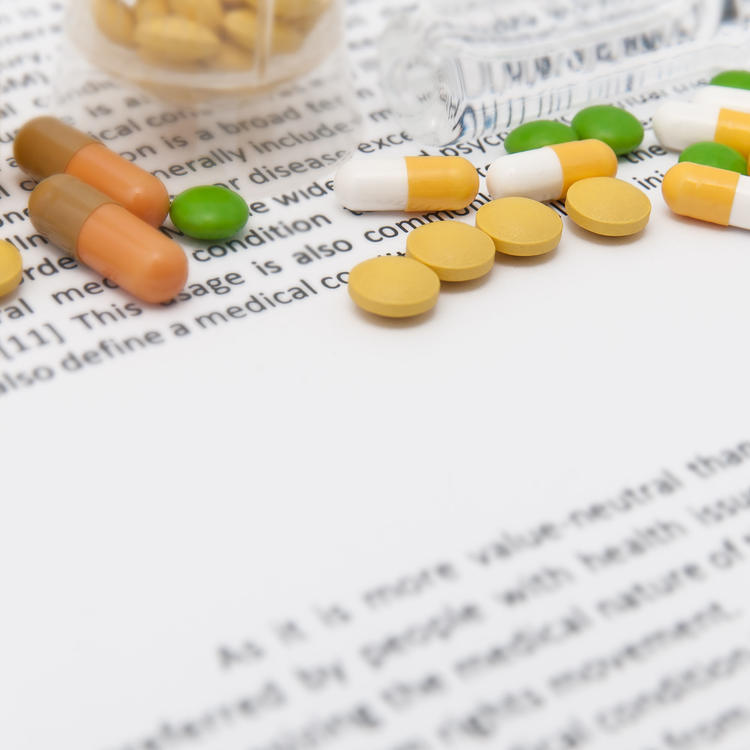 Pills on a medication leaflet printed on Century Premium Opaque paper made by Domtar